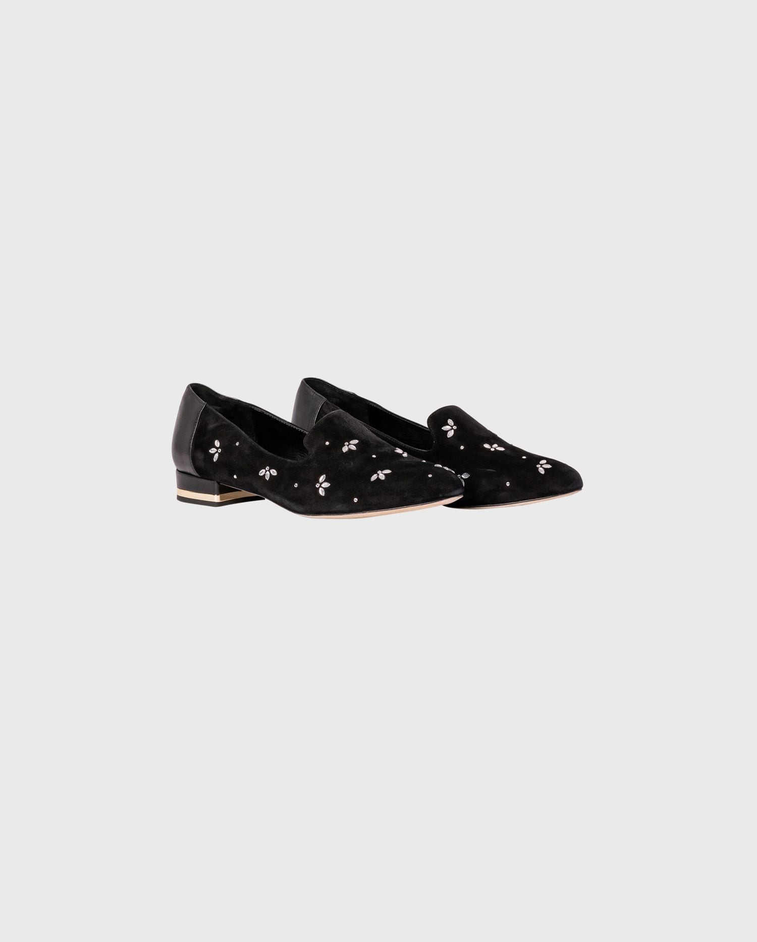 The NADIA suede and leather flats  with jewels are the perfect flat to add to your Parisian inspired look.