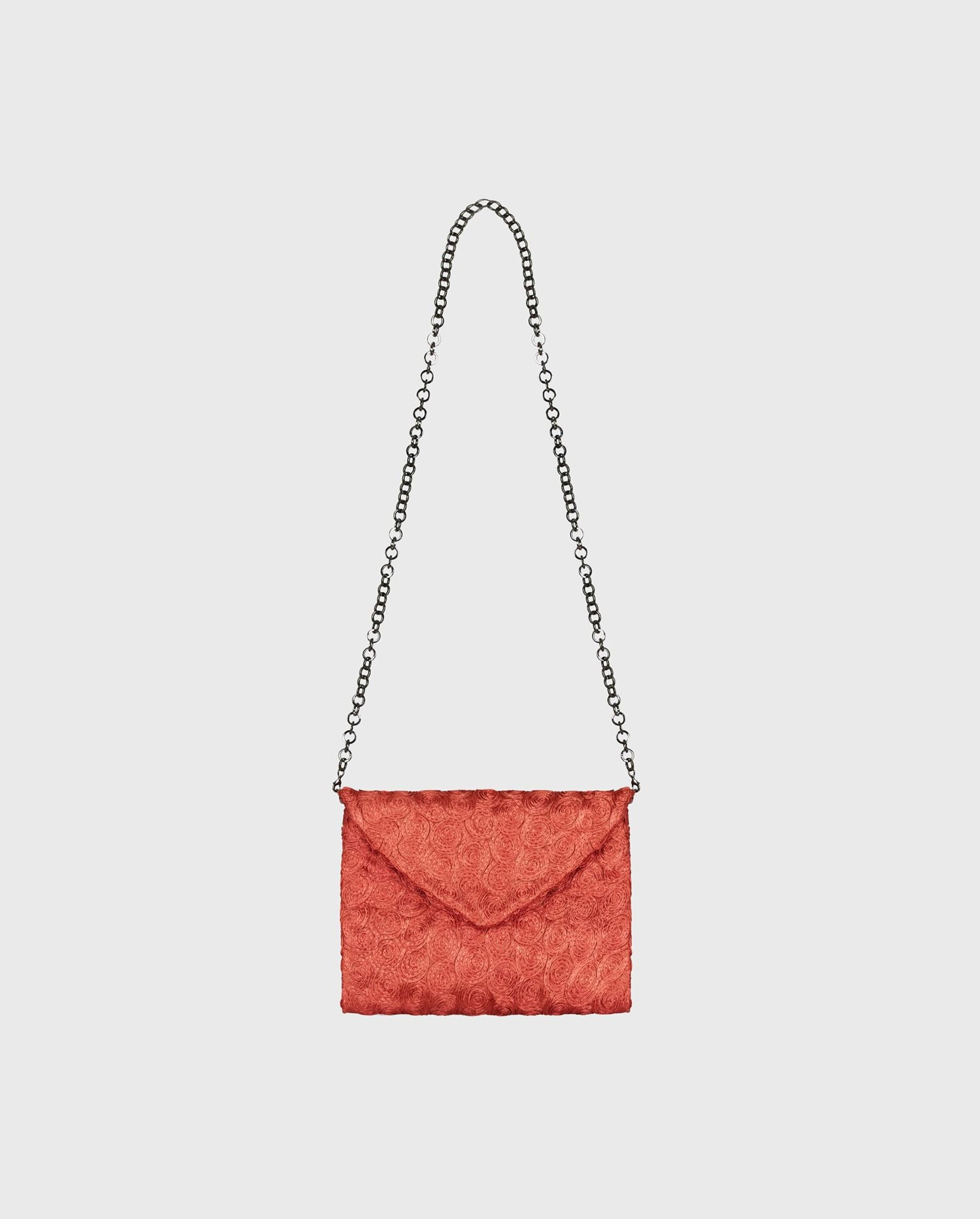 The red floral envelope NINA-PLT handbag will a pop of color to your look with ease